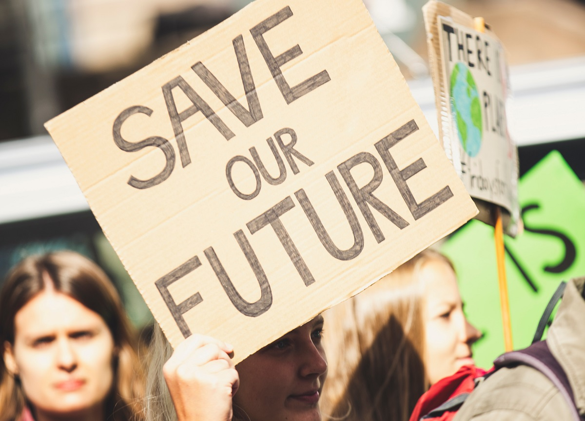"""Sign at a protest saying """"save our future"""""""