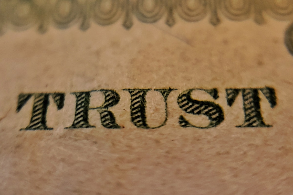 """The printed words, """"Trust."""""""